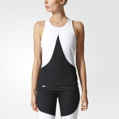 elevate your look on the courts or at the gym.  The adidas by Stella McCartney Training Tank Top gives a secure, supportive feel with a high neck and a built-in bra. It has sweat-wicking fabric and a glossy hem for a soft shine.