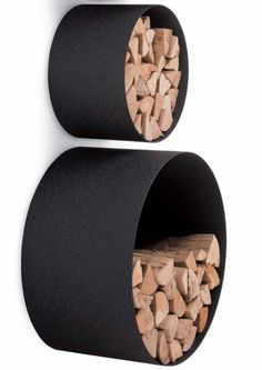 These elegant black storage units make firewood look like art. Stylish New AK47 Home Storage Solutions Really Pop | WebUrbanist