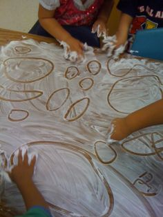learning to write by drawing in shaving cream; one of my favorite activities from when I was in kindergarten