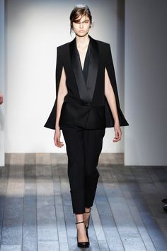 Victoria Beckham does the cape version of Le Smoking.  Be inspired and shop here: http://rstyle.me/n/p72tdbgbrf