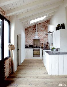 An exposed brick wall in a room doesn't always mean industrial. Moreover if we talk about the specific white brick wall, the style and design it suits will be way more than just one kind. House Design, House, Brick Kitchen, Home, Brick Wall Kitchen, Exposed Brick, House Styles, House Interior, Modern Kitchen Design