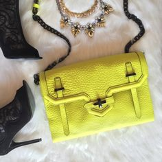 """Rebecca Minkoff Jules crossbody bag . HP  Carry around some sunshine!☀️This is no mellow yellow! In perfect condition but no tags. Wear it 3 ways: crossbody, shoulder, or remove the strap to make it a clutch. Approx 11.5"""" x 8.4"""" x 2"""", adjustable 11-19"""" chain strap, magnetic closure.  Photos via Glamour-zine, Eonline. Host picks by @ashleedawn California Cool, @withlovedesirie Best Dressed, @buysomelove Wardrobe Refresh, and @hila808 It Girl, @stylelinkmiami Minimalist Chic, @helloagainshop…"""