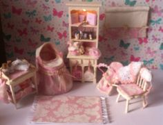 A personal favorite from my Etsy shop https://www.etsy.com/uk/listing/151441352/dolls-house-miniature-ooak-baby-nursery
