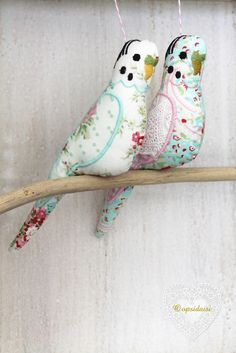 This sweet white fabric budgie features designer fabric with spotty tulle wings and embroidered features.The blue budgie features gingham
