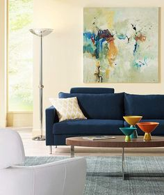 Contemporary Modern Living room. Dark Blue Couch perfect pop of color for an living space.