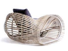 lolah armchair - rattan strip frame, build similar to traditional boat making - kenneth cobonpue