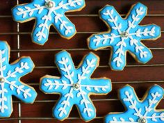 Blue snowflake sugar cookie.  Individually hand decorated to no two cookies are exactly alike.