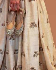 A match made in heaven, cream Ginkgo Lahenga & Shining Star ArpitaMehtaXNeedledust jootis! Punjabi Fashion, Indian Fashion, Indian Attire, Indian Wear, Indian Dresses, Indian Outfits, Indian Shoes, Bridal Sandals, Designer Wear