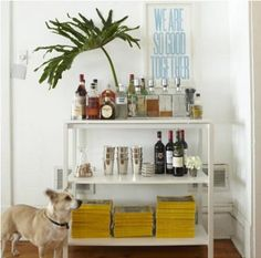 a simple bookshelf looks really cute! more opportunities for styling than a closed up sideboard.