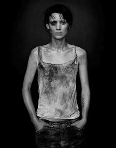 I love her expression here... sad but dangerous. RP: Rooney Mara in The Girl with the Dragon Tattoo.