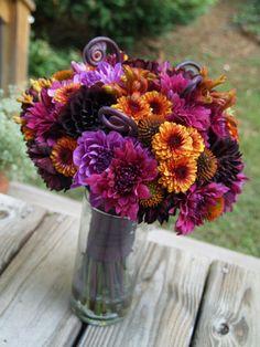 Black Dahlias, Purple Dahlias, Echinacea Pods, Fern Curls, Bronze Button Mums and Orange Kangaroo Paw.