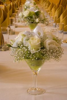 Holiday Centerpiece in a martini glass - very beautiful! red Roses would be pretty too!