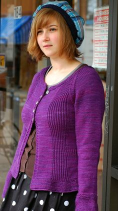 """Amelia Sweater by Laura Chau.  """"This feminine cardigan features deep garter stitch cuffs and a bit of a peplum, along with pintuck-inspired twisted rib panels. The scoop neck and slightly cropped length lets you show off a fun top underneath, and a bit of twisted rib at the waist accents your curves – or gives you the look of them!"""""""