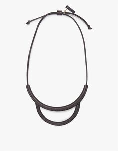 From Los Angeles-based Crescioni, a large hand stitched leather statement necklace in black with steel inserts and short leather cord.   • Leather statement necklace • Steel inserts • Short leather cord • Sits just under collar • Inspired by traditi