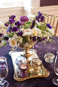 use antique looking silver/aluminum platters/vases/bowls..etc. You can find mix-matches pieces at any thrift store