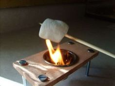 "If you've always wanted to make S'mores at home (or just roast a marshmallow for that yummy fresh-from-the-campfire taste), then here's a ""fire pit"" you're sure to dig. This homemade mini firepit isn't much bigger than a marshmallow itself, but. Eclairs, Indoor Grill, Indoor Smores, Thinking Day, Mini S, Cookies, Grilling, Picnic, Good Food"