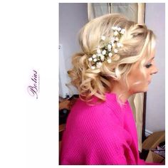 Another messy up do with a braid and flowers, this style really suited a young bridesmaid.  Bridal hair