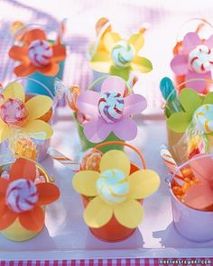 Flower-Power FavorsFor a baby shower or kids' birthday, fill pails (available at party-supply stores) with candy, and insert a paper daisy with a lollipop poked through its center in each pail.