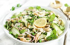 Spring Pea And Zucchini Pasta Salad With Whole Wheat Pasta, Peas, Medium Zucchini, Shallots, Mint Leaves, Parsley Leaves, Feta Cheese Crumbles, Lemon, Extra-virgin Olive Oil, Sea Salt, Cracked Black Pepper