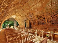 Japanese wedding chapel is lined with intricate hand-carved flowers to connect the past with the future