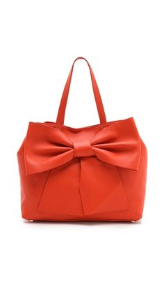 obsessed with this bold bow bag from valentino red!