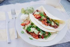 Kidney Bean Tacos // Spicy bean braise with spring onions and sour cream in a soft flour taco. // http://desiredcooking.com/recipes/kidney-bean-tacos
