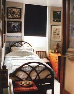 small cozy bedroom.  black shade.