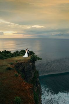 Sunset shoot on top of the cliff // Bali Wedding Photography by Maxtu Photography on OneThreeOneFour.com