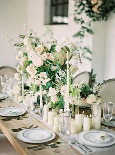 Incorporating various shapes and sizes onto the tabletop gives wedding guests different focal points to look at. Tall, skinny taper candles mixed with petite hurricane candles scattered among structured centerpieces makes for one harmonious spread.