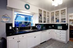 """Beautiful white custom bead board cabinetry and granite kitchen, the ocean views from the sink and breakfast area will invite you to just """"hang out"""" in this La Jolla home."""