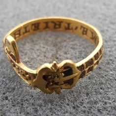 Metal detecting find: gold posie ring with belt motif. Engraved inside: Time Trieth Truth