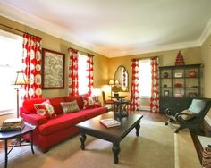 Pretty use of red couch...combined with tans, white and black (very rich looking, not 'gothic')