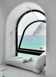 Cozy #reading nook! www.digiwriting.com Make time for reading | Reading nook with an ocean breeze.