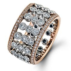 Caviar Collection - This fabulous 18K white and rose gold ring is comprised of .85ctw round white Diamonds. - MR2356