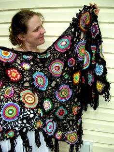 I totally wouldn't pay the 1000 they are asking for this, but love the colorful randomness. Thinking a great shawl instead of a nursing cover is a good idea.