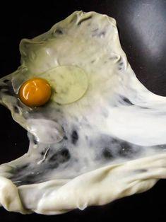 stretching the egg roti dough and adding egg. how to make egg paratha. Roti Paratha Recipe, Egg Paratha, Paratha Recipes, Flat Pan, Fluffy Eggs, How To Make Eggs, Dish Towels, Stretching, Street Food