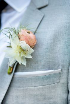 Brides.com: . An air plant and peach ranunculus boutonniere created by The Little Branch.