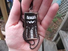 johnny the homicidal maniac long recycled comic book pendant. $18.00