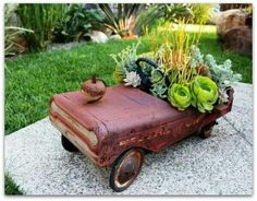 Old rusted toys or tools for planters
