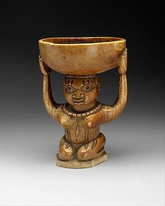 Ifa Divination Vessel: Female Caryatid (Agere Ifa) | 17th–19th century | Nigeria Culture: Yoruba peoples, Owo group | Medium: Ivory, wood or coconut shell inlay