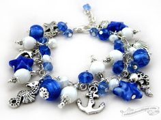 Marine blue starfish and white charm bracelet by OohlalaBeadtique, $25.00