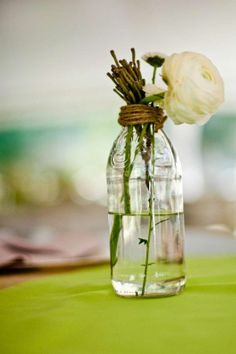 Glass Bottle Centerpieces for flowers :  wedding barn wedding bottles brown centerpieces ceremony flowers glass green outdoor reception romantic rustic vintage Bottle Centerpiece