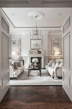 gray formal traditional classic living room 3 ideas English roll arm sofas - herringbone wood floor - extensive woodwork