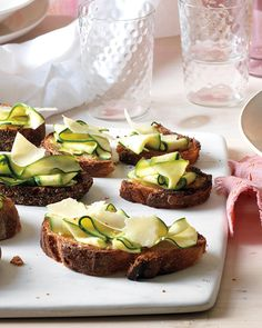 This is an easy hors d'oeuvre that uses thinly sliced marinated zucchini, with a drizzle of olive oil before and after broiling.