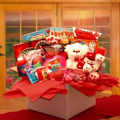"Little Sweethearts Valentines Care Package $62.99  Valentines gift with loads of fun stuff  11"" furry teddy bear, 4 sweet little cuddling teddy bears hugging, Bubbles, silly string, mini pinball game,   2 kids board games,   (see list on store page ( Kids card game,   8x11 coloring book, activity puzzle book,.   Powder candy potion bottle, Relaxable heart ball, caramel corn, 2-fun size M and M candies, Fun Dips candy,   Candy ring-pop, and a heart box with assorted mini toys."