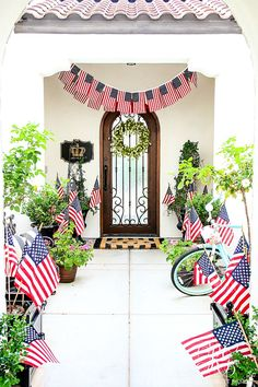 Fourth of July decor: American flags pennants in entry way! 30 Tips for Summer Decorating - Simple Tips to style your Home for Summer