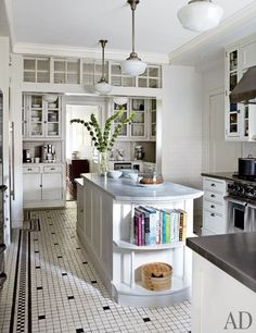 Michael J. Fox and Tracy Pollan's Manhattan Home.  The kitchen features classic schoolhouse light fixtures, Shaker-style cabinetry, and stainless-steel and marble countertops.