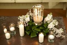 Image result for wedding flower table arrangements hurricane vase