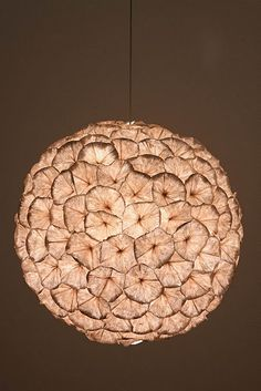 rhododendron chandelier from Anthropologie is made of clusters of paper flowers that add a soft, ethereal glow