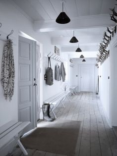 long white hallway with hooks and benches